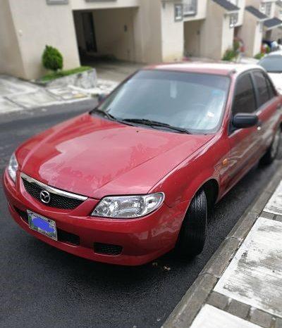 Mazda 323 2002 color rojo, de agencia, motor 1300, un solo dueño. El carro es 323, lo coloque en 3 porque no me aparece la opcion de 323.